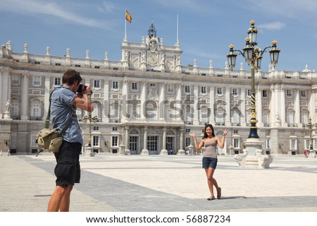 Royal Palace Madrid. Tourists taking pictures by the Palacio de Oriente - the Royal Palace of Madrid.