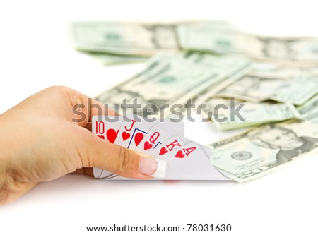 Royal poker in female hand with money background - stock photo