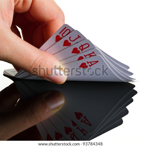 Royal poker in the hand with reflection