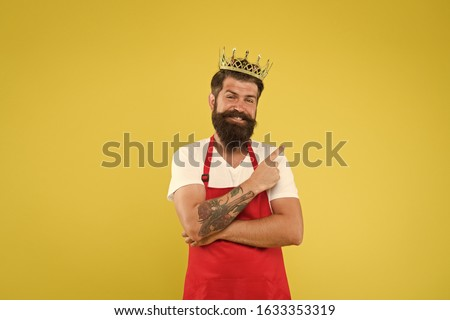 Royal recipe. Man king cook wear cooking apron and golden crown. Kingdom of tastes. Chief cook and professional culinary. Premium quality. Cook food. Cook with beard and mustache yellow background.