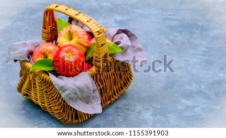 Royal Red Gala red apples with green leaf on the basket with empty space for your text. Rich in antioxidants and healthy eating for everybody