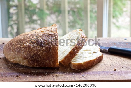 Photo of Royalty free stock image of a fresh loaf of crusty bread on a cutting board