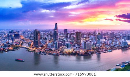 Photo of Royalty high quality free stock image aerial view of boats in river side ho chi minh, Vietnam. The biggest city in Vietnam, Vietnam. Boats in river side ho chi minh