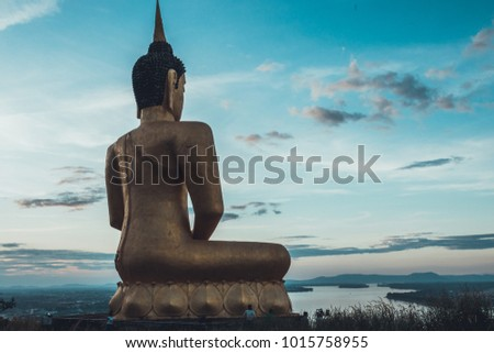 Royalty high quality free stock image of The Golden Buddha at Phu Salao temple overlooking the Mekong river and the city of Pakse, Laos. PAKSE Township is in Champasak Province, Southern Laos