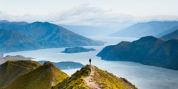 Roys peak beautiful mountain landscape background. Lake Wanaka New Zealand. Top view mountains overlooking scenic view of alpine landscape. Hiking in New Zealand. Popular tourism and travel location