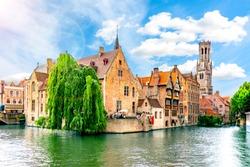 Rozenhoedkaai canal and Belfort tower, Bruges, Belgium