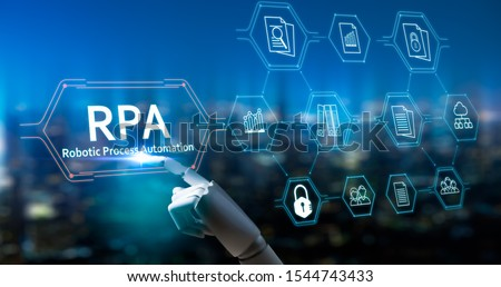 RPA (Robotic Process Automation system),Artificial intelligence , Robot finger,robo advisor ,Big data and business concept.Robot finger on blurred background using digital RPA interface. Stock photo ©