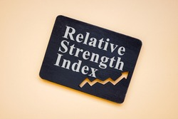 RSI Relative Strength Index words on the black plate.