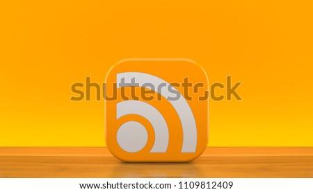 RSS icon on orange background. 3d illustration