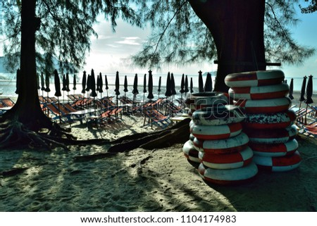 Rubber beach umbrella, beach umbrella, beach chair for rent at gulf of Thailand, Thailand #1104174983
