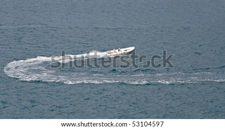 Rubber boat moving on sea