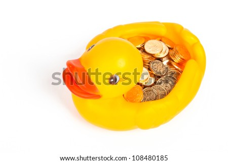 Rubber duck and coin - stock photo