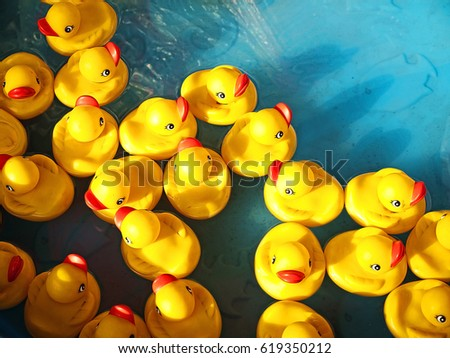 rubber ducks in a children's pool #619350212