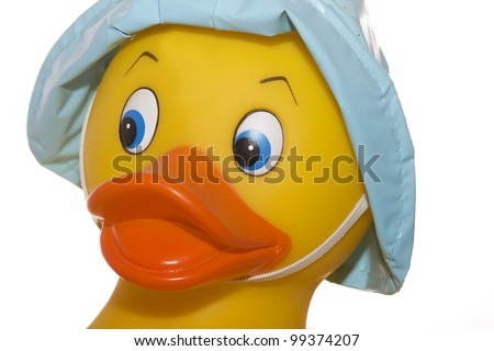 RUBBER DUCKY  FACE CLOSEUP WEARING BLUE RAIN-HAT