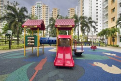 Rubber Ducky Theme Children Playground with Red Slides in Public Housing in Singapore Punggol District