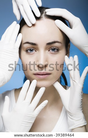 rubber gloves touching womans face