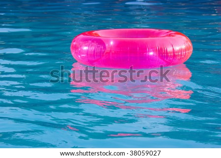 rubber ring in the swimming pool sunny day