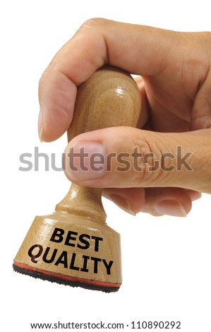 rubber stamp in hand marked with best quality - stock photo
