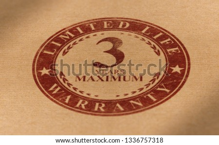 Rubber stamp mark over paper background with the following text, 3 years maximum limited life warranty. Planned obsolescence concept, product with short lifetime #1336757318
