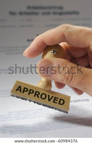 rubber stamp marked with approved