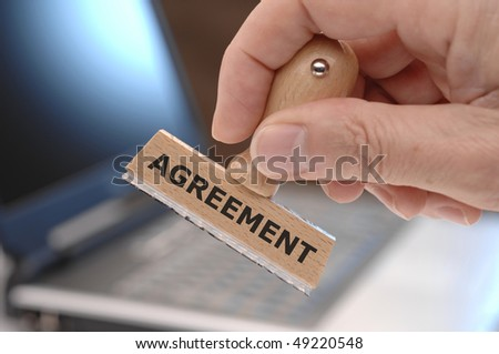 rubber stamp with inscription AGREEMENT
