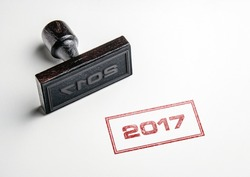 Rubber stamping that says '2017'.