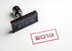 Rubber stamping that says '2019'.