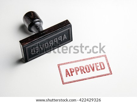 Rubber stamping that says 'Approved'.