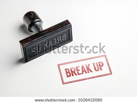 Rubber stamping that says 'Break Up'.