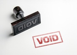 Rubber stamping that says 'Void'.
