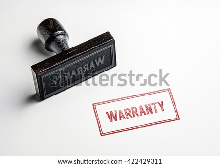 Rubber stamping that says 'Warranty'. #422429311