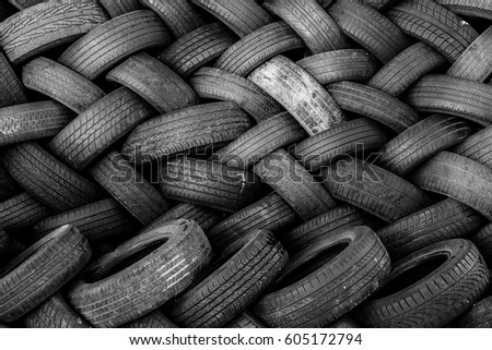 Rubber tire recycling. old used car tires  at a junkyard in piles waiting for recycle. #605172794