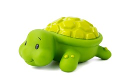 Rubber toy green turtle on a white background. Child's toy green turtle isolated over white background.