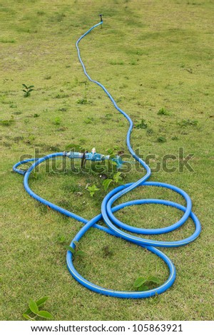 Rubber tube on green grass field