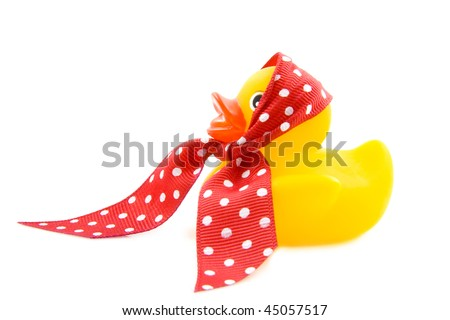 Rubber yellow duck with spotted red white shawl isolated over white