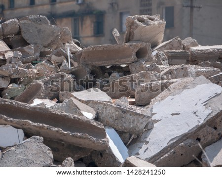 Rubble of destroyed/demolished brick buildings. Construction and demolition waste.