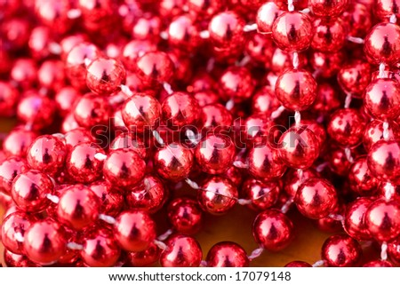 Ruby colored necklace balls close-up