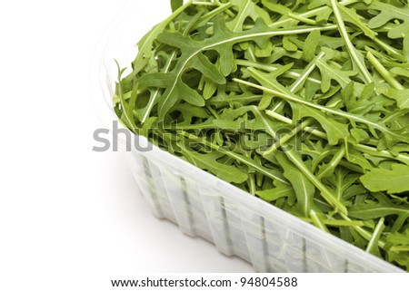 rucola in a plastic box