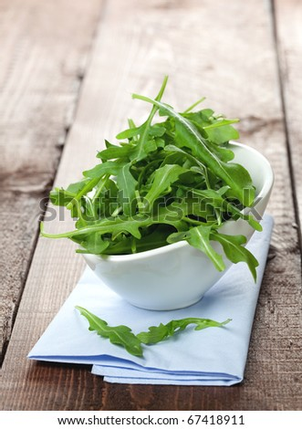 rucola in white bowl on napkin