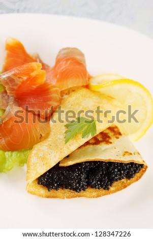 ruddy flapjack with caviar and smoked salmon