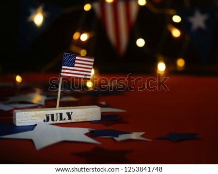Ruffled American flag and wooden cube calendar with 4th of July, USA Independence Day date, copy space celebratory background. US patriotic festive composition, close up, concept, holiday, patriotism #1253841748