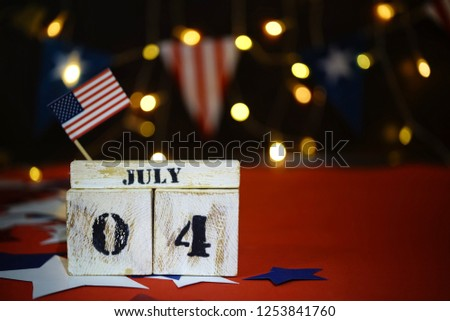 Ruffled American flag and wooden cube calendar with 4th of July, USA Independence Day date, copy space celebratory background. US patriotic festive composition, close up, concept, holiday, patriotism #1253841760