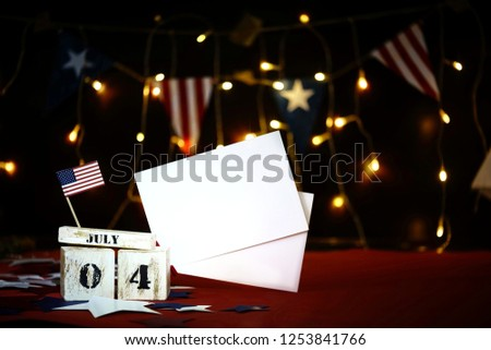 Ruffled American flag and wooden cube calendar with 4th of July, USA Independence Day date, copy space celebratory background. US patriotic festive composition, close up, concept, holiday, patriotism #1253841766