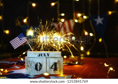 Ruffled American flag and wooden cube calendar with 4th of July, USA Independence Day date, copy space celebratory background. US patriotic festive composition, close up, concept, holiday, patriotism #1253841769