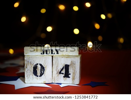 Ruffled American flag and wooden cube calendar with 4th of July, USA Independence Day date, copy space celebratory background. US patriotic festive composition, close up, concept, holiday, patriotism #1253841772