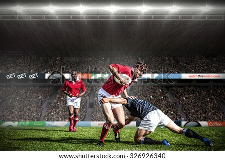 Rugby fans in arena against rugby players tackling during game Сток-фото ©
