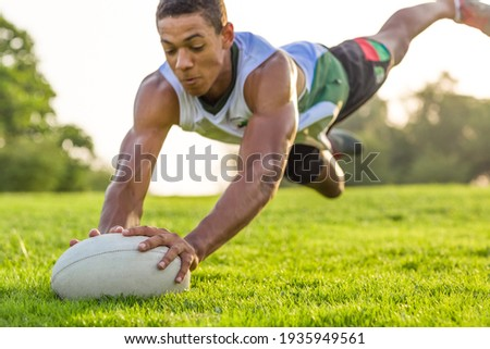 Rugby player diving for the ball in the air action.  Foto d'archivio ©