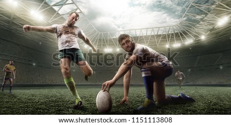 Rugby player knocked the ball on professional rugby stadium