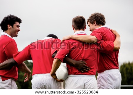 Rugby players celebrating a win at the park