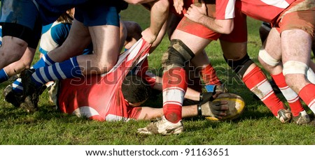 rugby scrum with a man lying down